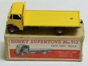 Dinky DINKY #512 GUY FLAT TRUCK, 1st CAB, RARE YELLOW W/ BLACK WINGS, RED HUBS-EXC/BOX