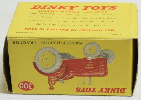 Dinky DINKY #300 MASSEY-HARRIS TRACTOR, RED W/ YELLOW METAL WHEELS, YELLOW PICTURE BOX